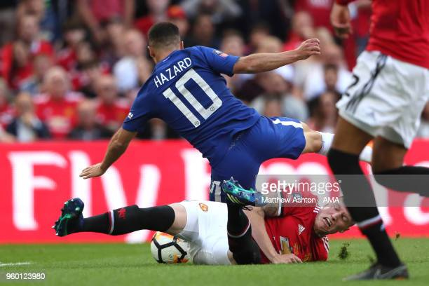 Phil Jones of Manchester United fouls Eden Hazard of Chelsea to concede a penalty during the Emirates FA Cup Final between Chelsea and Manchester...