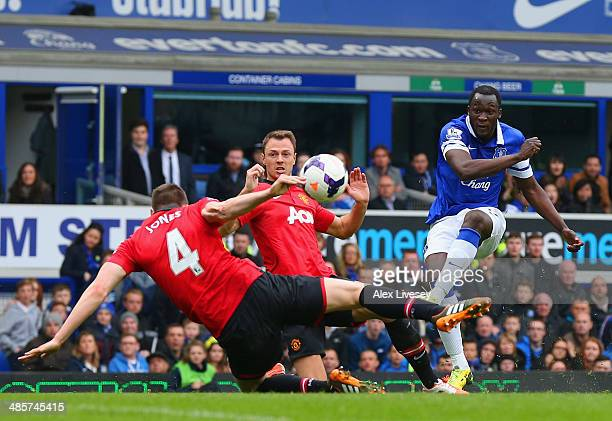 Phil Jones of Manchester United handles the ball in the area and Everton win a penalty during the Barclays Premier League match between Everton and...
