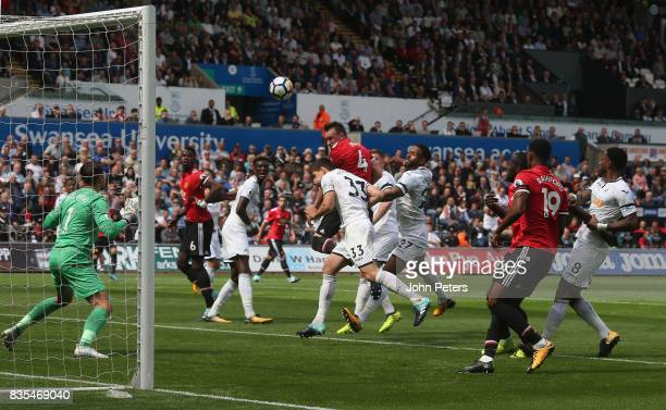 Phil Jones of Manchester United has a header on goal during the Premier League match between Swansea City and Manchester United at Liberty Stadium on...