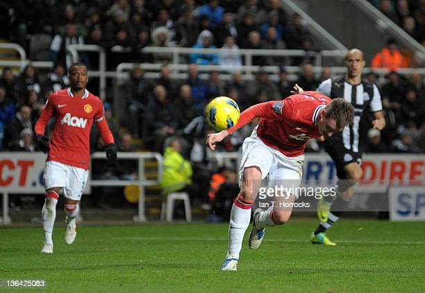 Phil Jones of Manchester United heads in to his own net for the third goal during the Barclays Premier League match between Newcastle United and...