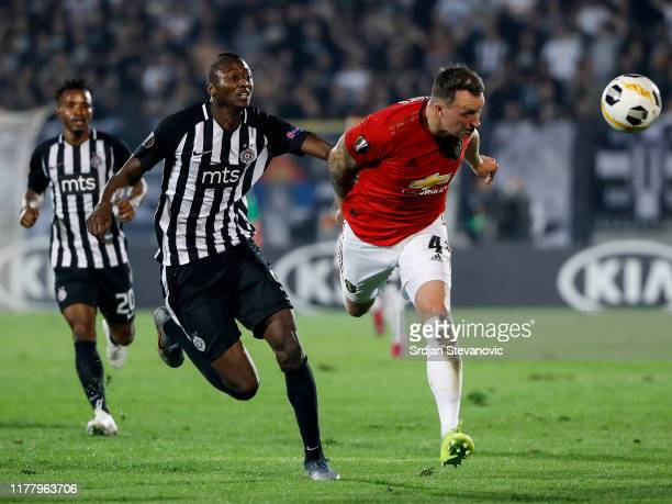 Phil Jones of Manchester United in action against Umar Sadiq of Partizan during the UEFA Europa League group L match between Partizan and Manchester...
