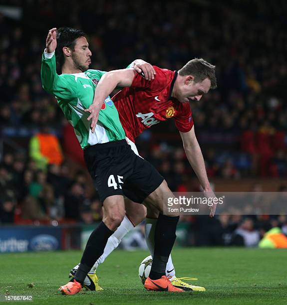 Phil Jones of Manchester United in action with Camora of CFR 1907 Cluj during the UEFA Champions League Group H match between Manchester United and...
