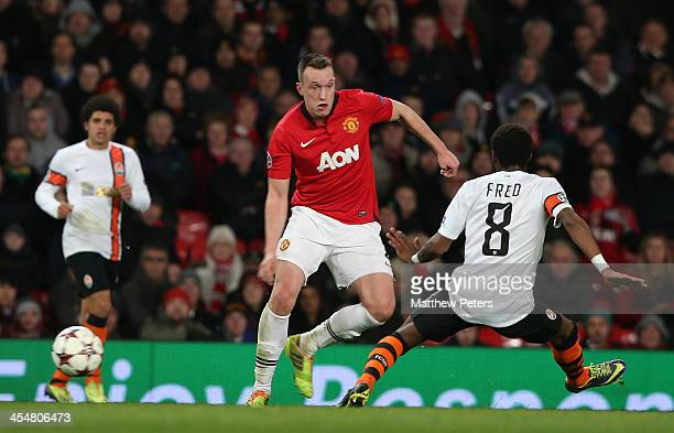 Phil Jones of Manchester United in action with Fred of Shakhtar Donetsk during the UEFA Champions League Group A match between Manchester United and...