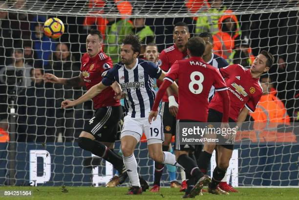 Phil Jones of Manchester United in action with Jay Rodriguez of West Bromwich Albion during the Premier League match between West Bromwich Albion and...