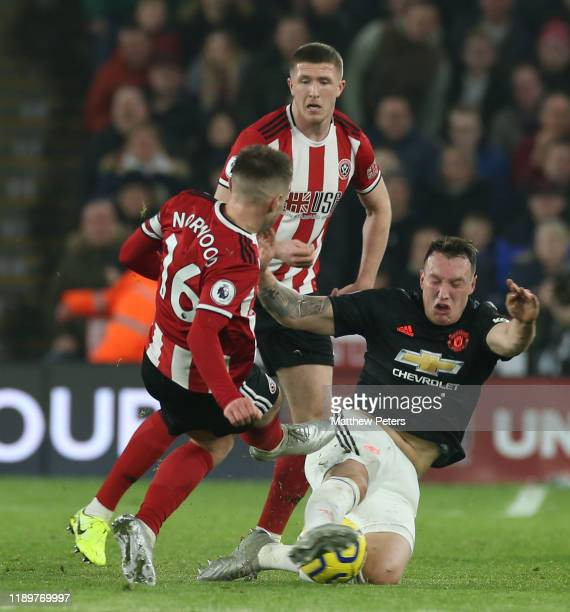Phil Jones of Manchester United in action with Oliver Norwood of Sheffield United during the Premier League match between Sheffield United and...