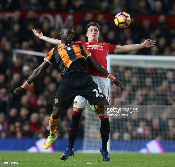 Phil Jones of Manchester United in action with Omar Niasse of Hull City during the Premier League match between Manchester United and Hull City at...