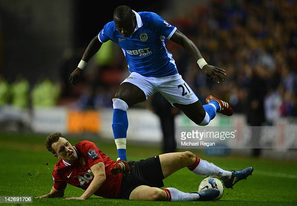 Phil Jones of Manchester United injures himself in a tackle on Mohamed Diame of Wigan during the Barclays Premier League match between Wigan Athletic...