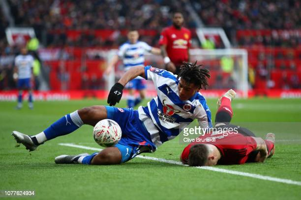 Phil Jones of Manchester United is brought down by Danny Loader of Reading during the FA Cup Third Round match between Manchester United and Reading...