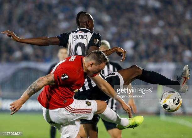 Phil Jones of Manchester United is challenged by Umar Sadiq of Partizan during the UEFA Europa League group L match between Partizan and Manchester...
