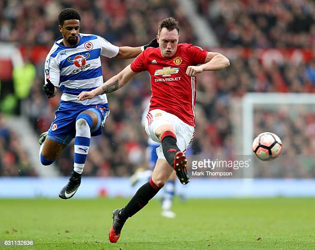 Phil Jones of Manchester United is closed down by Garath McCleary of Reading during the Emirates FA Cup third round match between Manchester United...