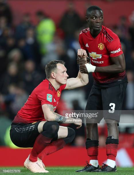 Phil Jones of Manchester United is consoled by Eric Bailly after missing his penalty during the shoot out during the Carabao Cup Third Round match...