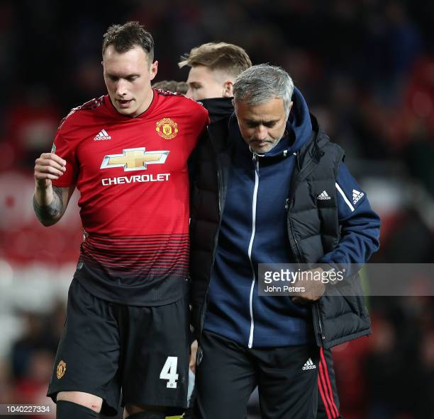 Phil Jones of Manchester United is consoled by Manager Jose Mourinho after missing his penalty during the shoot out during the Carabao Cup Third...