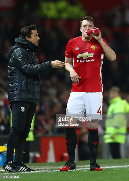 Phil Jones of Manchester United is given instructions by Manchester United Assistant Manager Rui Faria during the EFL Cup quarter final match between...