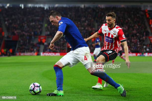 Phil Jones of Manchester United is put under pressure from Jay Rodriguez of Southampton during the Premier League match between Southampton and...