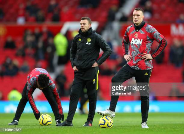 Phil Jones of Manchester United looks on whilst wearing a special edition Chinese New Year kit prior to the Premier League match between Manchester...