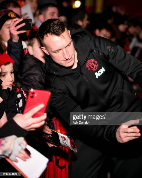 Phil Jones of Manchester United meets fans after the Premier League match between Manchester United and Wolverhampton Wanderers at Old Trafford on...