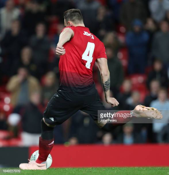 Phil Jones of Manchester United misses his penalty during the shoot out during the Carabao Cup Third Round match between Manchester United and Derby...