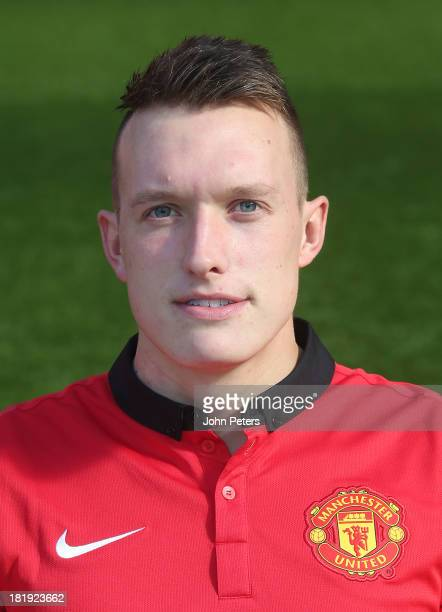 Phil Jones of Manchester United poses at the annual club photocall at Old Trafford on September 26 2013 in Manchester England