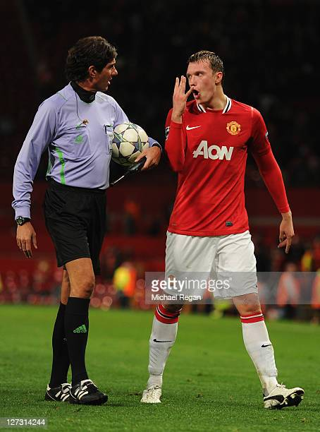 Phil Jones of Manchester United protests to a match official after the UEFA Champions League Group C match between Manchester United and FC Basel at...