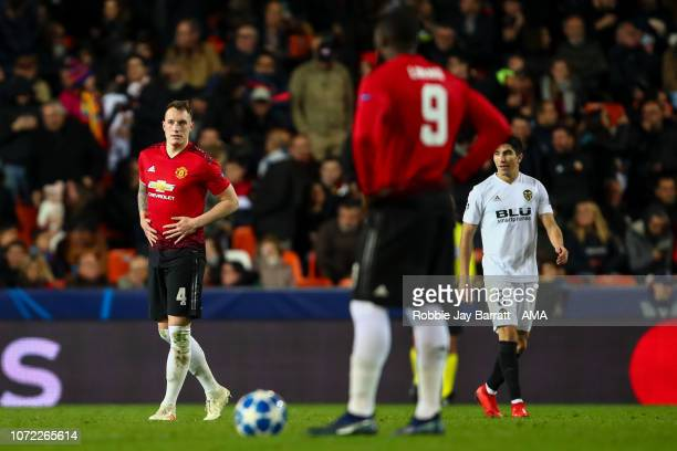 Phil Jones of Manchester United reacts after conceding an own goal to make it 20 during the UEFA Champions League Group H match between Valencia and...