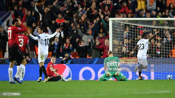 Phil Jones of Manchester United reacts after he scores an own goal during the UEFA Champions League Group H match between Valencia and Manchester...