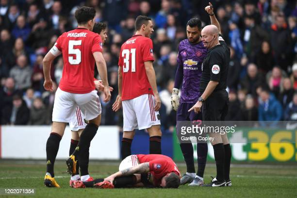 Phil Jones of Manchester United reacts to an injury during the FA Cup Fourth Round match between Tranmere Rovers and Manchester United at Prenton...