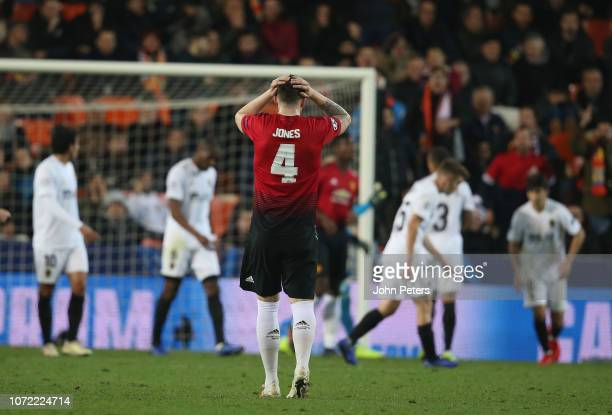 Phil Jones of Manchester United reacts to conceding a goal to Carlos Soler of Valencia during the UEFA Champions League Group H match between...