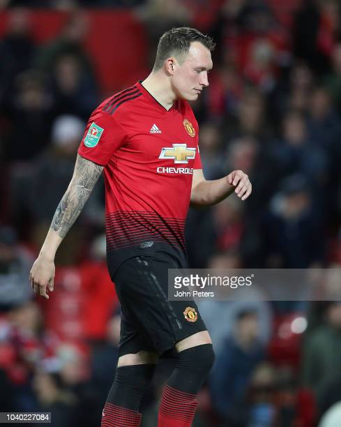 Phil Jones of Manchester United reacts to missing his penalty during the shoot out during the Carabao Cup Third Round match between Manchester United...