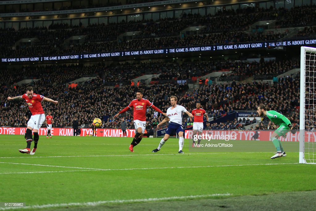 Phil Jones of Manchester United scores an own goal during the Premier League match between Tottenham Hotspur and Manchester United at Wembley Stadium on January 31, 2018 in London, England.