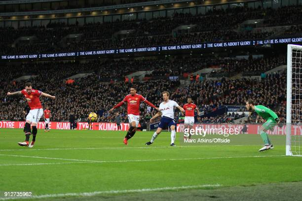 Phil Jones of Manchester United scores an own goal during the Premier League match between Tottenham Hotspur and Manchester United at Wembley Stadium...