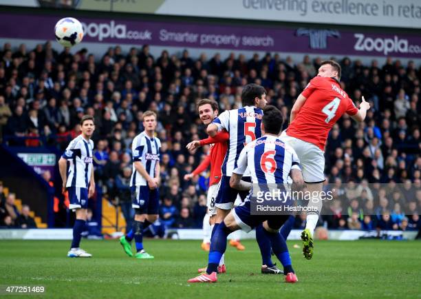 Phil Jones of Manchester United scores their first goal with a header during the Barclays Premier League match between West Bromwich Albion and...