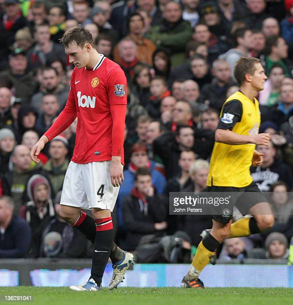 Phil Jones of Manchester United shows his disappointment during the Barclays Premier League match between Manchester United and Blackburn Rovers at...