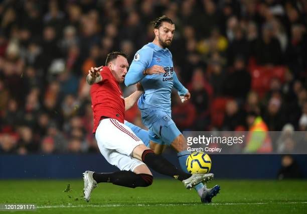 Phil Jones of Manchester United tackles Jay Rodriguez of Burnley during the Premier League match between Manchester United and Burnley FC at Old...