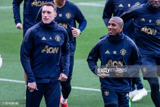 04 Phil Jones of Manchester United talking with 18 Ashley Young of Manchester United during the training session before the second leg Champions...