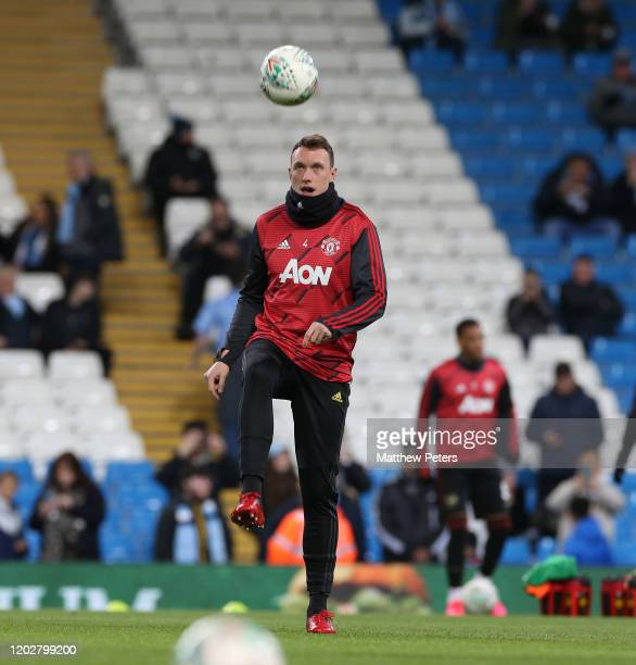Phil Jones of Manchester United warms up ahead of the Carabao Cup Semi Final match between Manchester City and Manchester United at Etihad Stadium on...