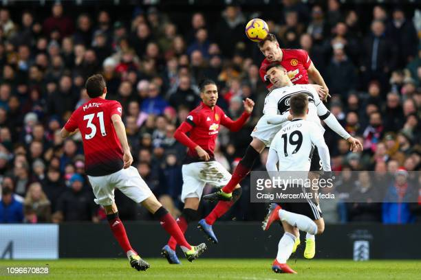 Phil Jones of Manchester United wins a header from Aleksandar Mitrovic of Fulham during the Premier League match between Fulham FC and Manchester...