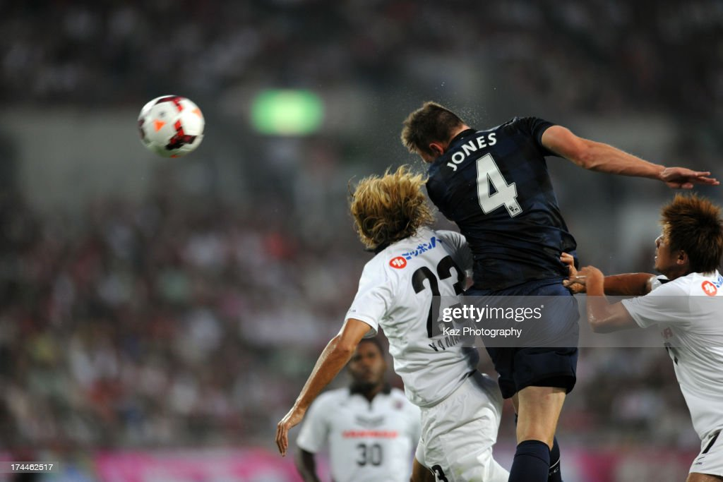 Phil Jones of Manchester United wins the header over Tatsuya Yamashita of Cerezo Osaka during the pre-season friendly match between Cerezo Osaka and Manchester United at Nagai Stadium on July 26, 2013 in Osaka, Japan.