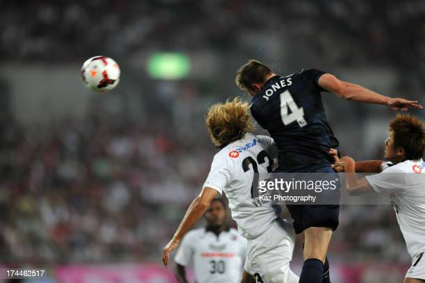 Phil Jones of Manchester United wins the header over Tatsuya Yamashita of Cerezo Osaka during the pre-season friendly match between Cerezo Osaka and...