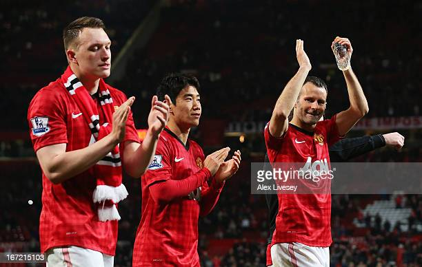 Phil Jones, Shinji Kagawa and Ryan Giggs of Manchester United celebrate victory and winning the Premier League title after the Barclays Premier...