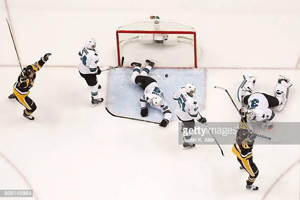 Phil Kessel and Chris Kunitz of the Pittsburgh Penguins celebrate after Evgeni Malkin scored a goal against Martin Jones of the San Jose Sharks...