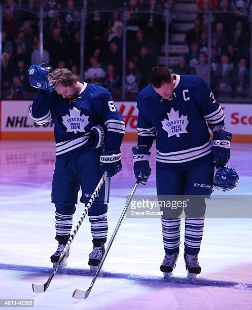 TORONTO ON JANUARY 7 Phil Kessel and Dion Phaneuf listen to the anthems as the Toronto Maple Leafs play the Washington Capitals at the Air Canada...