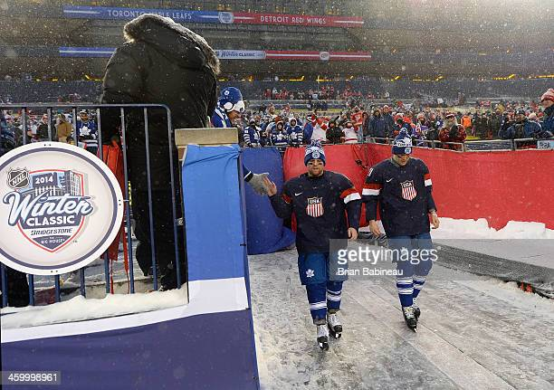 Phil Kessel and James van Riemsdyk of the Toronto Maple Leafs walk back to the ice surface after being selected to the US Men's Nation Team for the...