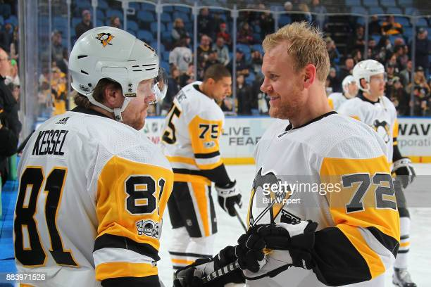Phil Kessel and Patric Hornqvist of the Pittsburgh Penguins chat before an NHL game against the Buffalo Sabres on December 1 2017 at KeyBank Center...