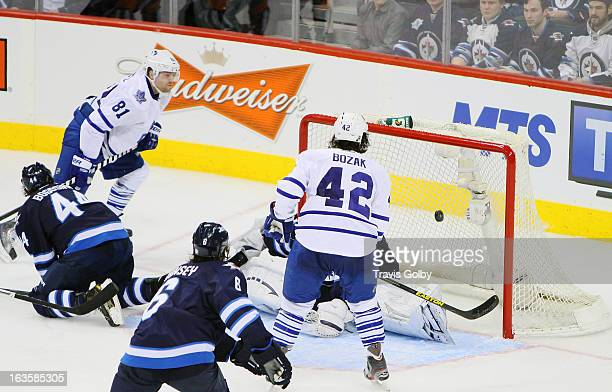 Phil Kessel and Tyler Bozak of the Toronto Maple Leafs watch as the puck goes in behind goaltender Ondrej Pavelec of the Winnipeg Jets for Kessel's...