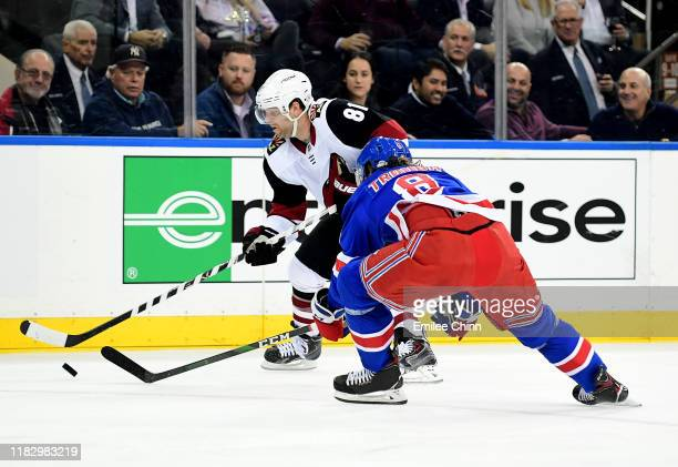 Phil Kessel of the Arizona Coyotes and Jacob Trouba of the New York Rangers fight for the puck during their game at Madison Square Garden on October...