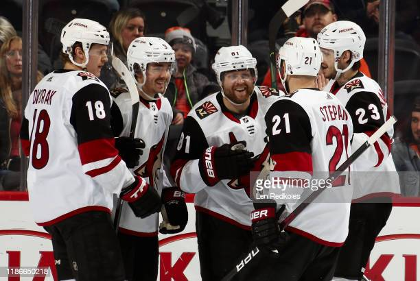 Phil Kessel of the Arizona Coyotes celebrates his first period powerplay goal against the Philadelphia Flyers with Christian Dvorak Clayton Keller...
