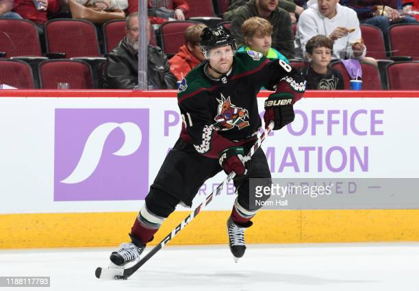 Phil Kessel of the Arizona Coyotes skates with the puck against the Calgary Flames at Gila River Arena on November 16 2019 in Glendale Arizona