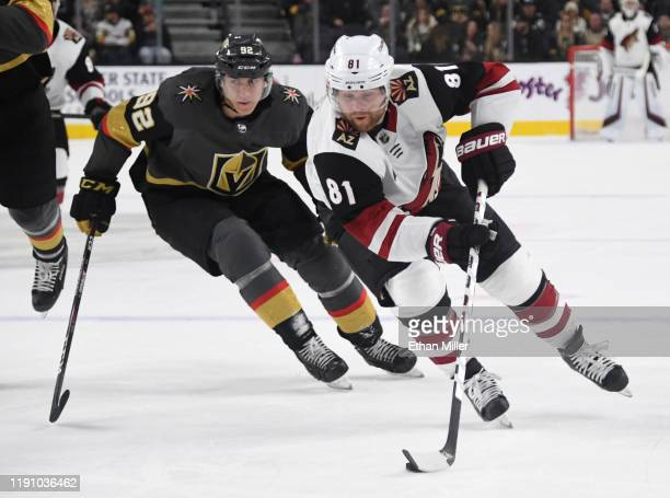 Phil Kessel of the Arizona Coyotes skates with the puck ahead of Tomas Nosek of the Vegas Golden Knights in the third period of their game at TMobile...