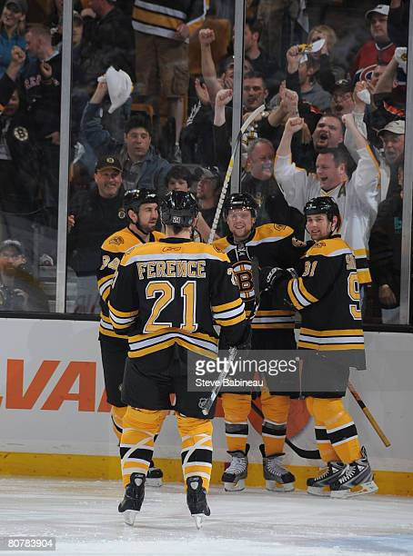 Phil Kessel of the Boston Bruins celebrates goal with teammates Shane Hnidy Marc Savard and Andrew Ference game six of the 2008 NHL conference...