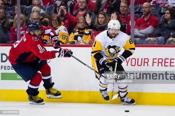 Phil Kessel of the Pittsburgh Penguins and Alex Ovechkin of the Washington Capitals battle for the puck in the first period at Capital One Arena on...